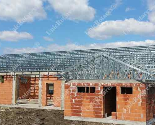 Steel roof over bricks building